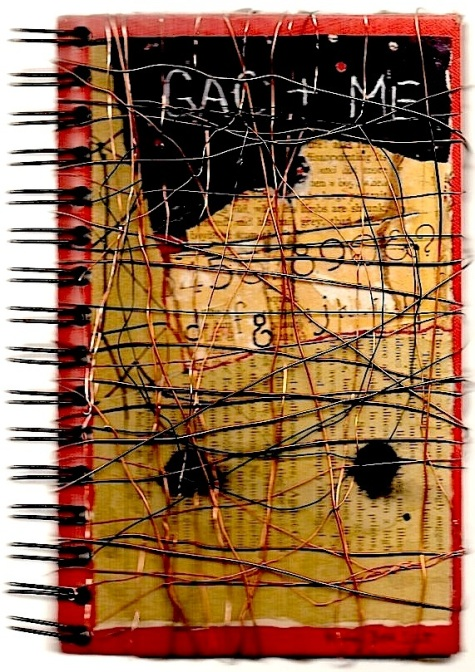 collaged and wire-wrapped notebook